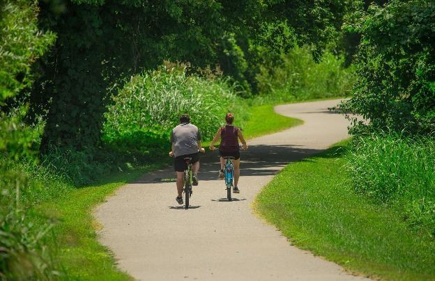 Couple Riding Bikes on Greenway