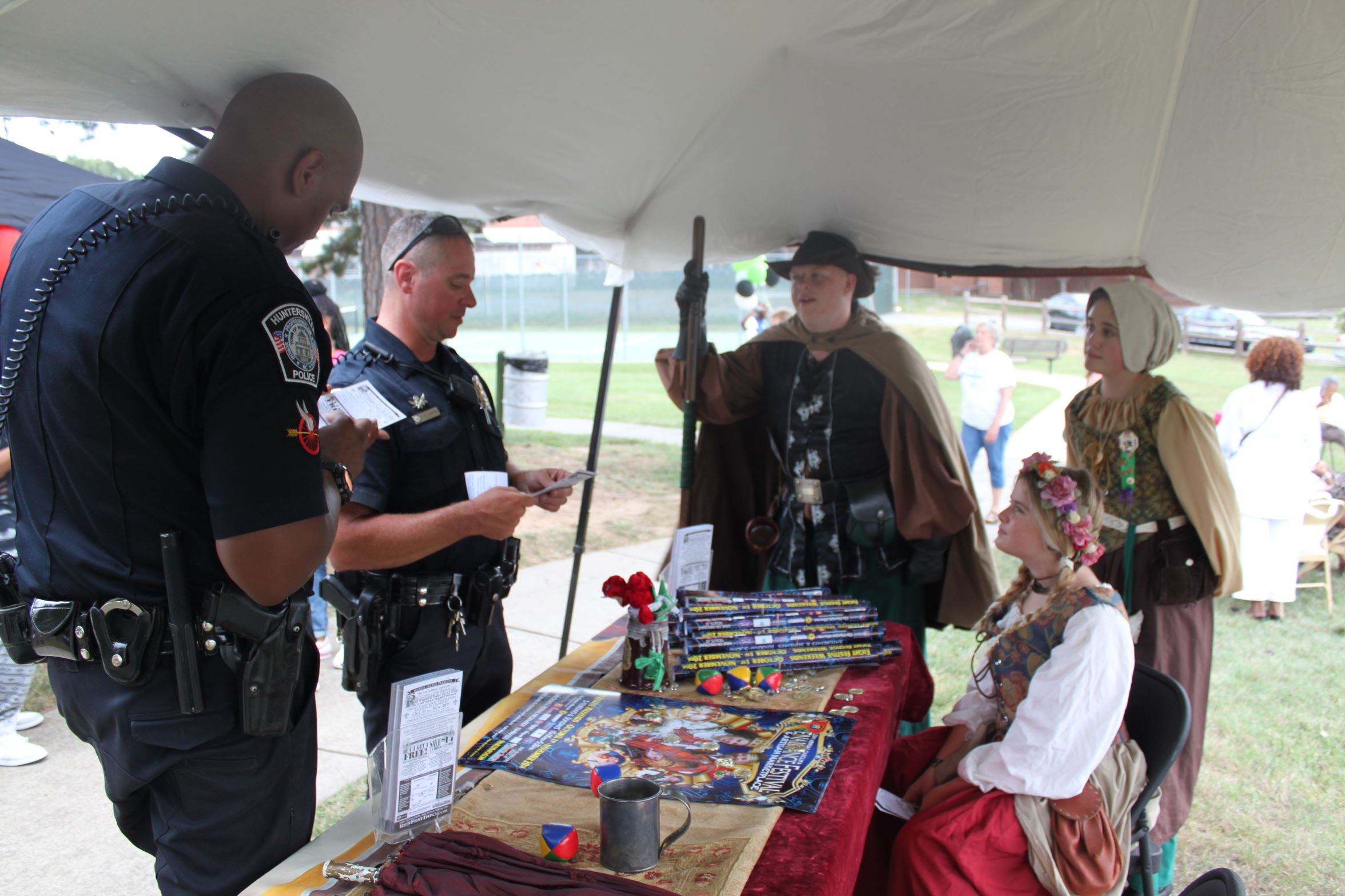 Officers under tent with role players